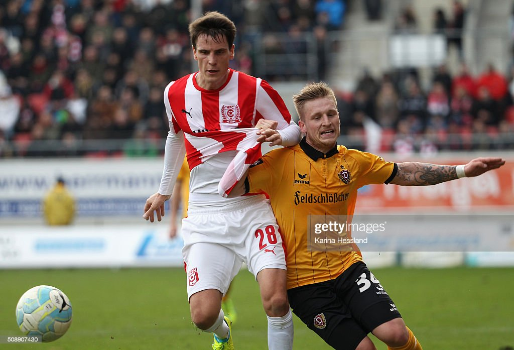 Jonas Acquistapace of Halle challenges Marvin Stefaniak of Dresden during the Third League match between Hallescher FC and SG Dynamo Dresden at erdgas Sportpark on February 07, 2016 in Halle, Germany.