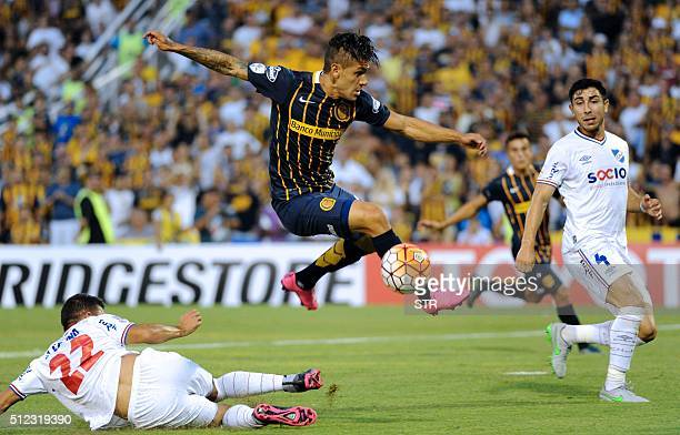 Jonas Aguirre of Argentina's Rosario Central vies for the ball with Alfonso Espino of Uruguay's Nacional during a Copa Libertadores 2016 football...