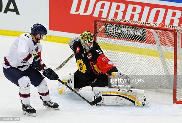 Jonas Almtorp of Linkoping HC scores behind goaltender Erik Hanses of Skelleftea AIK during the Champions Hockey League quarter final first leg game...