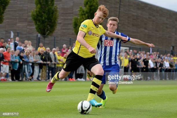 Jonas Arweiler of Dortmund vies with Nils Blumberg of Hertha BSC during the B juniors bundesliga semi final match between Borussia Dortmund and...