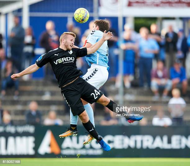 Jonas Bager of Randers FC and Mikael Uhre of SonderjyskE compete for the ball during the Danish Alka Superliga match between SonderjyskE and Randers...
