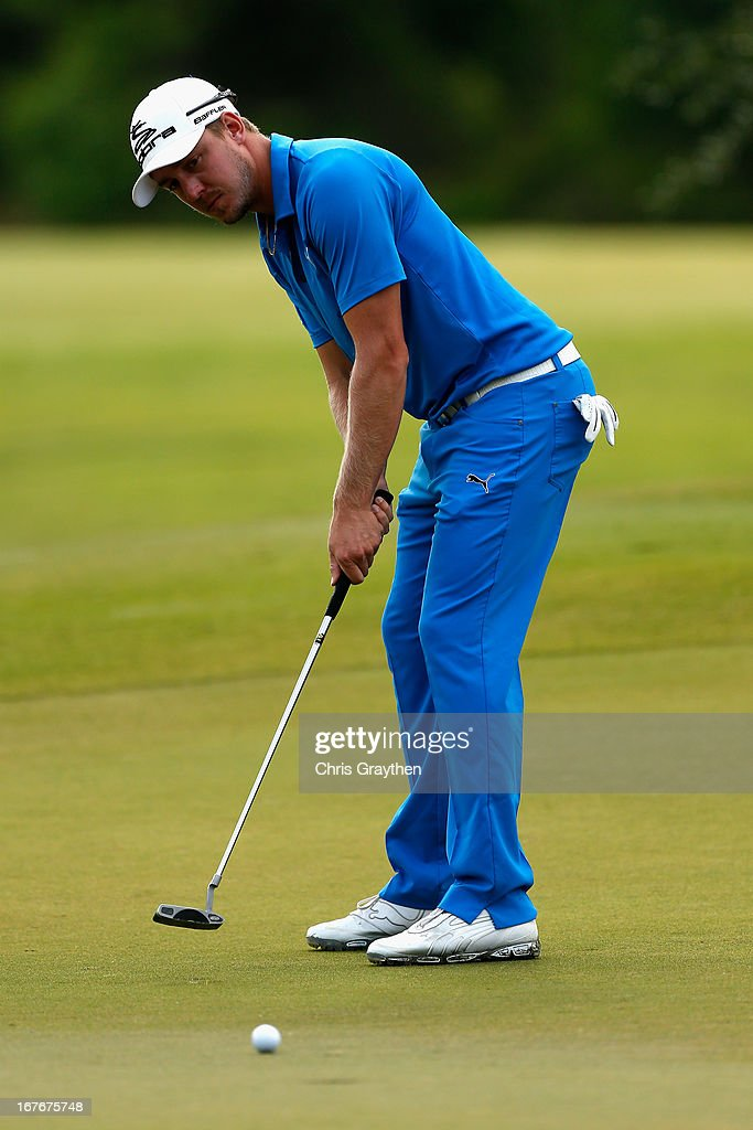 Jonas Blixt makes a putt on the first hole during the third round of the Zurich Classic of New Orleans at TPC Louisiana on April 27, 2013 in Avondale, Louisiana.