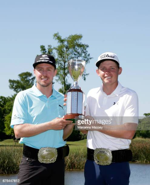 Jonas Blixt of Sweden and Cameron Smith of Australia pose with the trophy after winning in a suddendeath playoff during a continuation of the final...
