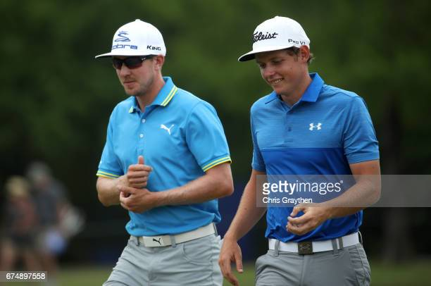 Jonas Blixt of Sweden and Cameron Smith of Australia react to their putt on the sixth green during the third round of the Zurich Classic at TPC...