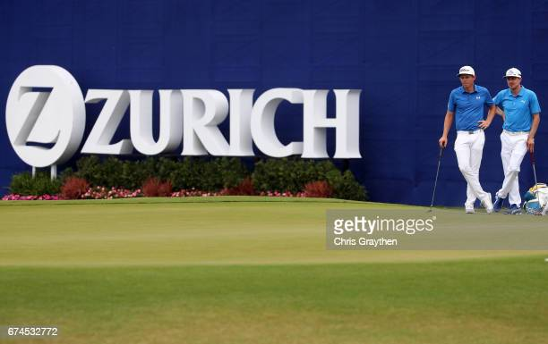 Jonas Blixt of Sweden and Cameron Smith of Australia wait to putt on the ninth hole during the second round of the Zurich Classic at TPC Louisiana on...