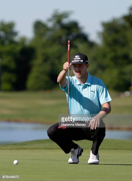 Jonas Blixt of Sweden lines up a putt in a suddendeath playoff during a continuation of the final round of the Zurich Classic at TPC Louisiana on May...