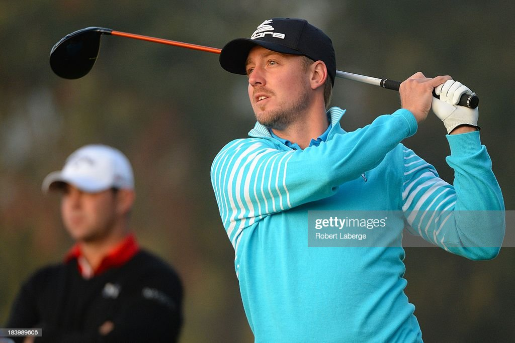 <a gi-track='captionPersonalityLinkClicked' href=/galleries/search?phrase=Jonas+Blixt&family=editorial&specificpeople=4387884 ng-click='$event.stopPropagation()'>Jonas Blixt</a> of Sweden makes a tee shot on the 10th hole as <a gi-track='captionPersonalityLinkClicked' href=/galleries/search?phrase=Gary+Woodland&family=editorial&specificpeople=5358131 ng-click='$event.stopPropagation()'>Gary Woodland</a> looks on during round one of the Frys.com Open at the CordeValle Golf Club on October 10, 2013 in San Martin, California.