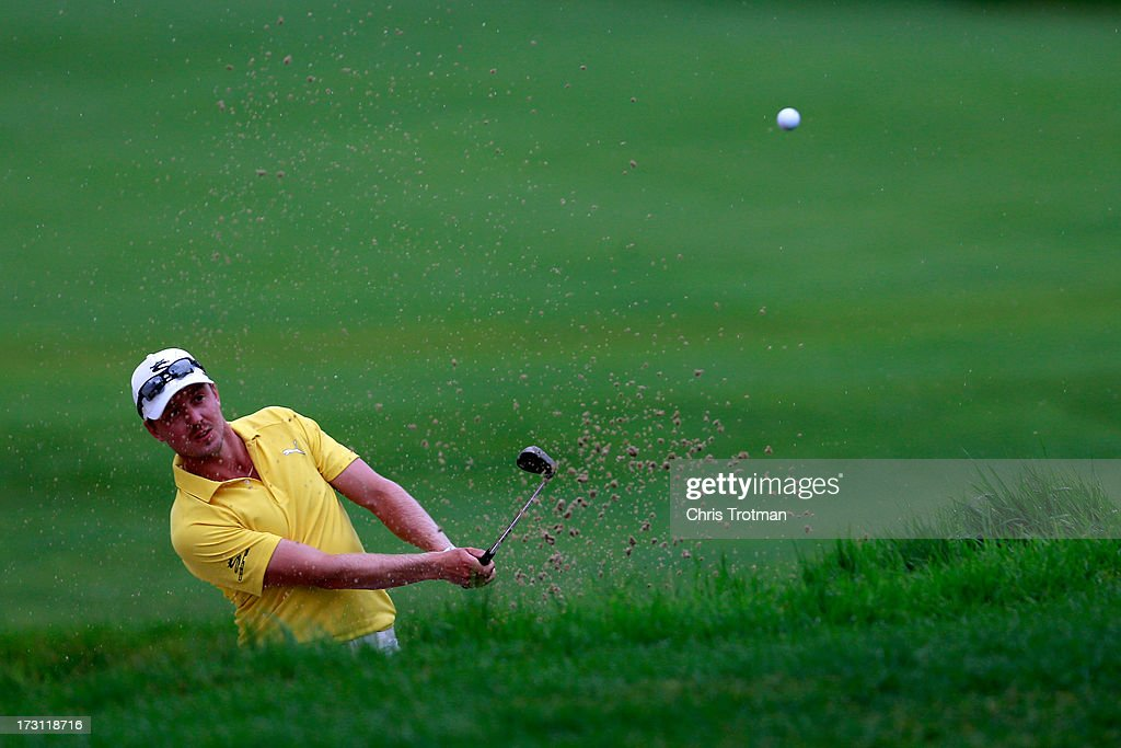 Jonas Blixt of Sweden watches his third shot on the second hole during the final round of the Greenbrier Classic at the Old White TPC on July 7, 2013 in White Sulphur Springs, West Virginia.