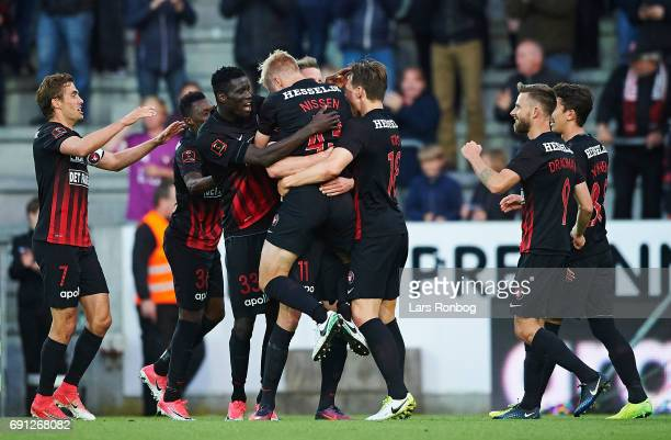 Jonas Borring and Rasmus Nissen of FC Midtjylland celebrate after scoring their third goal during the Danish Alka Superliga Europa League Playoff...