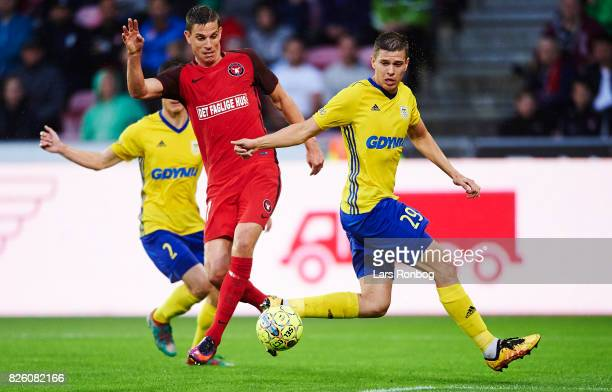 Jonas Borring of FC Midtjylland and Michal Marcjanik of Arka Gdynia compete for the ball during the UEFA Europa League Qualification 3rd round 2th...