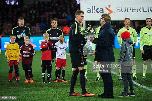 Jonas Borring of FC Midtjylland receives flowers from Claus Steinlein sports director of FC Midtjylland prior to the Danish Alka Superliga match...