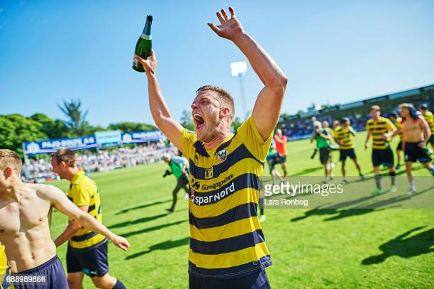 Jonas BrixDamborg of Hobro IK celebrate winning the match and the NordicBet LIGA with promotion to the Alka Superliga after the Danish NordicBet LIGA...