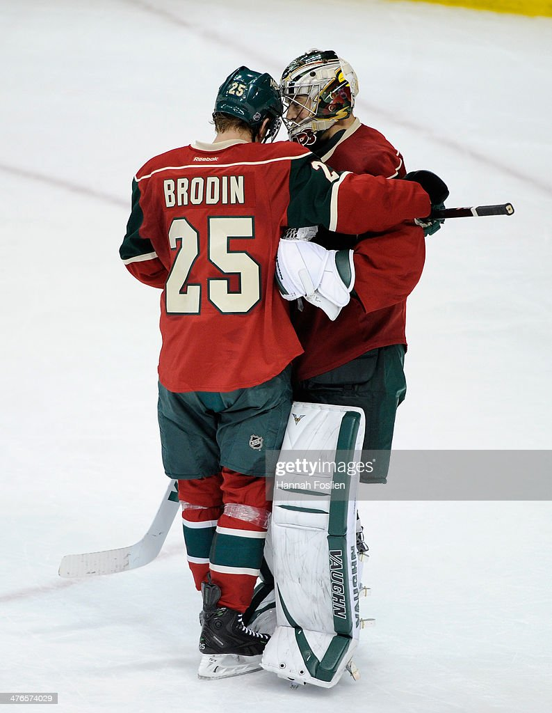 <a gi-track='captionPersonalityLinkClicked' href=/galleries/search?phrase=Jonas+Brodin&family=editorial&specificpeople=7832272 ng-click='$event.stopPropagation()'>Jonas Brodin</a> #25 and <a gi-track='captionPersonalityLinkClicked' href=/galleries/search?phrase=Darcy+Kuemper&family=editorial&specificpeople=6270733 ng-click='$event.stopPropagation()'>Darcy Kuemper</a> #35 of the Minnesota Wild celebrate a win of the game against the Calgary Flames on March 3, 2014 at Xcel Energy Center in St Paul, Minnesota. The Wild defeated the Flames 3-2.