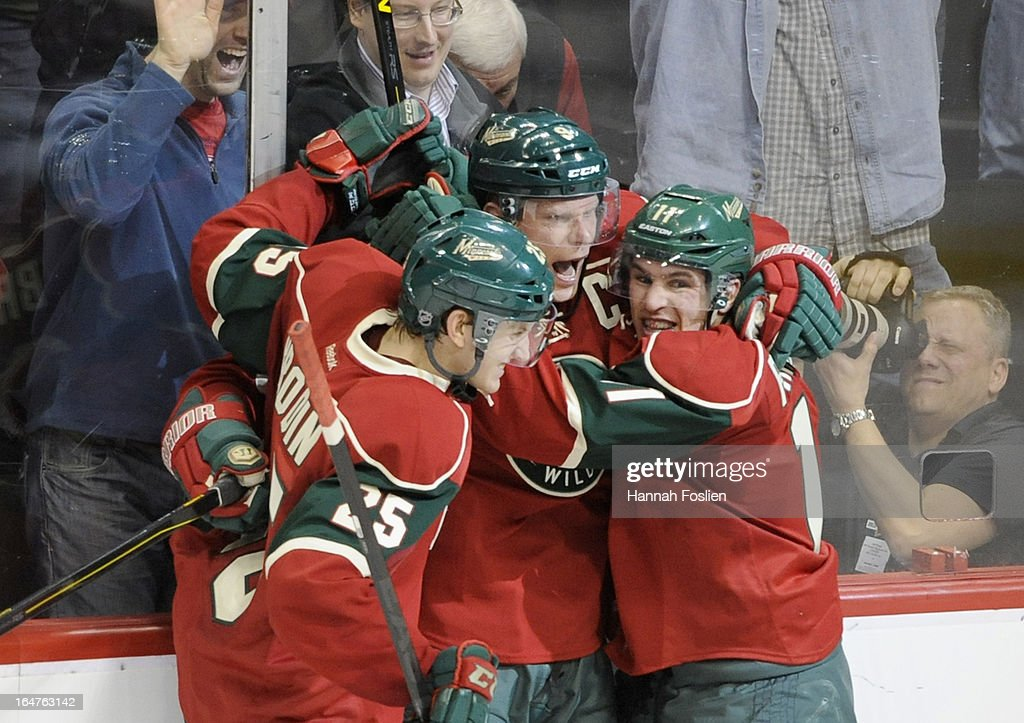 Jonas Brodin #25, <a gi-track='captionPersonalityLinkClicked' href=/galleries/search?phrase=Mikko+Koivu&family=editorial&specificpeople=584987 ng-click='$event.stopPropagation()'>Mikko Koivu</a> #9 and <a gi-track='captionPersonalityLinkClicked' href=/galleries/search?phrase=Zach+Parise&family=editorial&specificpeople=213606 ng-click='$event.stopPropagation()'>Zach Parise</a> #11 of the Minnesota Wild celebrate the winning goal by Koivu in overtime of the game against the Phoenix Coyotes on March 27, 2013 at Xcel Energy Center in St Paul, Minnesota. The Wild defeated the Coyotes 4-3 in overtime.