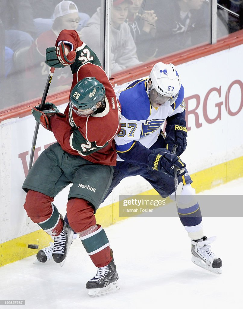 Jonas Brodin #25 of the Minnesota Wild and <a gi-track='captionPersonalityLinkClicked' href=/galleries/search?phrase=David+Perron&family=editorial&specificpeople=4282591 ng-click='$event.stopPropagation()'>David Perron</a> #57 of the St. Louis Blues go after the puck during the third period of the game on April 11, 2013 at Xcel Energy Center in St Paul, Minnesota. The Blues defeated the Wild 2-0.