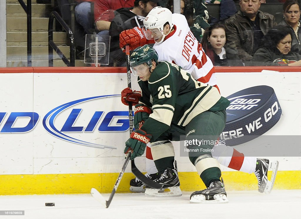 Jonas Brodin #25 of the Minnesota Wild and <a gi-track='captionPersonalityLinkClicked' href=/galleries/search?phrase=Pavel+Datsyuk&family=editorial&specificpeople=202893 ng-click='$event.stopPropagation()'>Pavel Datsyuk</a> #13 of the Detroit Red Wings go after a loose puck along the boards during the third period of the game on February 17, 2013 at Xcel Energy Center in St Paul, Minnesota. The Wild defeated the Red Wings 3-2.