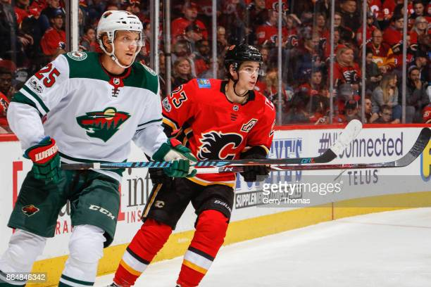 Jonas Brodin of the Minnesota Wild and Sean Monahan of the Calgary Flames in an NHL game against the Minnesota Wild at the Scotiabank Saddledome on...