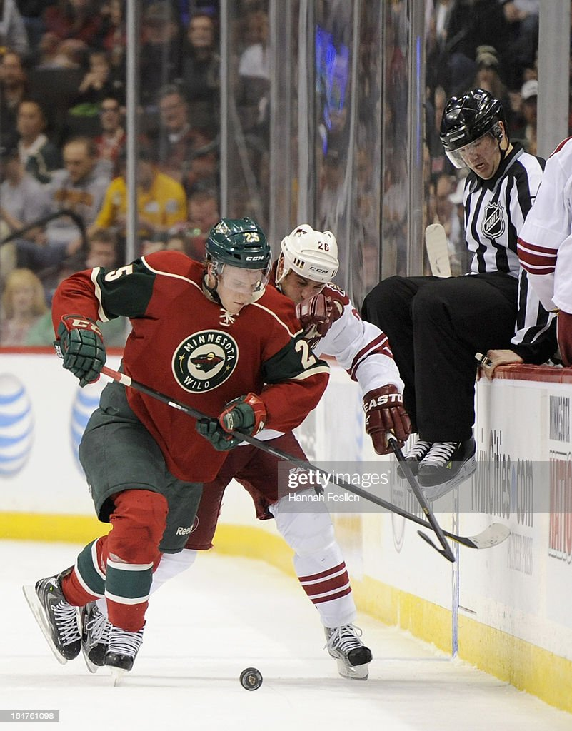 Jonas Brodin #25 of the Minnesota Wild and Steve Sullivan #26 of the Phoenix Coyotes skate after the puck during the first period of the game on March 27, 2013 at Xcel Energy Center in St Paul, Minnesota.