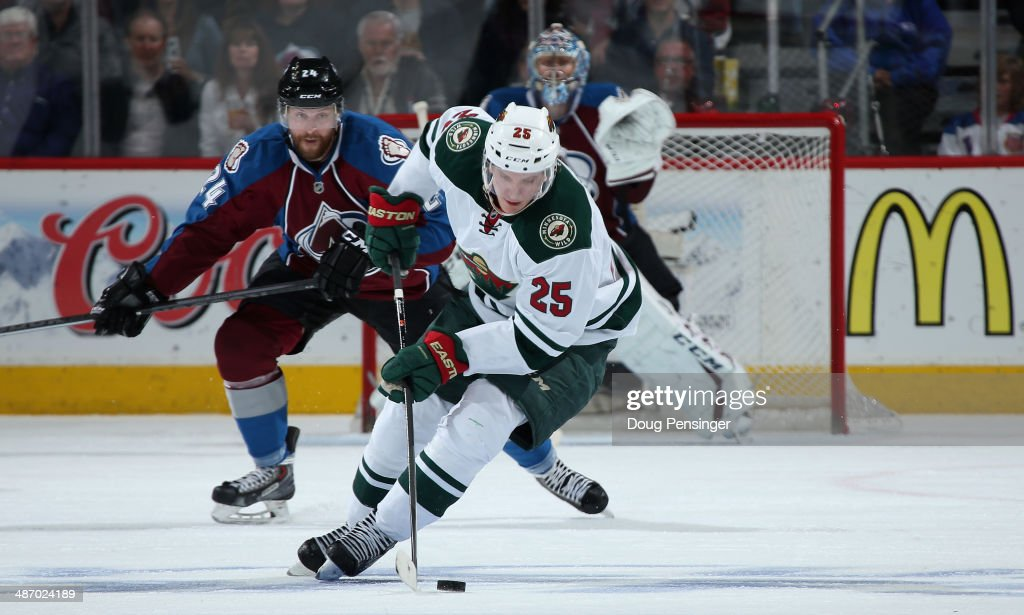<a gi-track='captionPersonalityLinkClicked' href=/galleries/search?phrase=Jonas+Brodin&family=editorial&specificpeople=7832272 ng-click='$event.stopPropagation()'>Jonas Brodin</a> #25 of the Minnesota Wild controls the puck against Marc-Andre Cliche #24 of the Colorado Avalanche as goalie <a gi-track='captionPersonalityLinkClicked' href=/galleries/search?phrase=Semyon+Varlamov&family=editorial&specificpeople=6264893 ng-click='$event.stopPropagation()'>Semyon Varlamov</a> #1 of the Colorado Avalanche defends the goal in Game Five of the First Round of the 2014 NHL Stanley Cup Playoffs at Pepsi Center on April 26, 2014 in Denver, Colorado. The Avalanche defeated the Wild 4-3 in overtime to take a 3-2 game lead in the series.