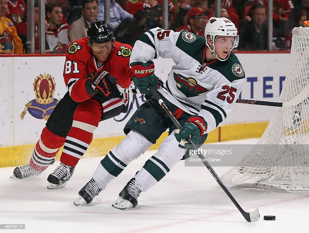 Jonas Brodin #25 of the Minnesota Wild controls the puck in under pressure from Marian Hossa #81 of the Chicago Blackhawks in Game Five of the Second Round of the 2014 NHL Stanley Cup Playoffs at the United Center on May 11, 2014 in Chicago, Illinois. The Blackhawks defeated the Wild 2-1.