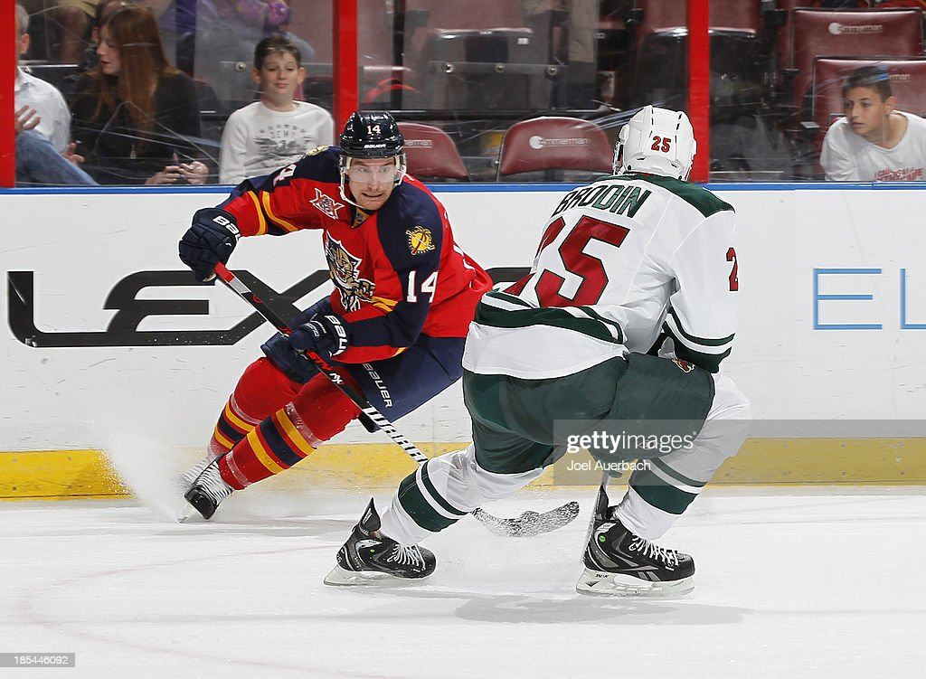 Jonas Brodin #25 of the Minnesota Wild defends against Tomas Fleischmann #14 of the Florida Panthers as he skates with the puck at the BB&T Center on October 19, 2013 in Sunrise, Florida. The Panthers defeated the Wild 2-1 in a shoot-out.