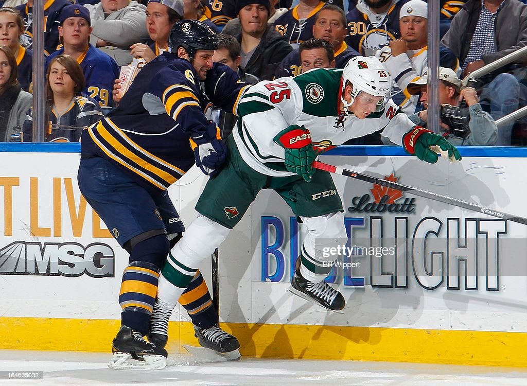 <a gi-track='captionPersonalityLinkClicked' href=/galleries/search?phrase=Jonas+Brodin&family=editorial&specificpeople=7832272 ng-click='$event.stopPropagation()'>Jonas Brodin</a> #25 of the Minnesota Wild elludes a check from Mike Weber #6 of the Buffalo Sabres on October 14, 2013 at the First Niagara Center in Buffalo, New York.
