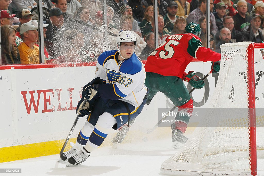 Jonas Brodin #25 of the Minnesota Wild handles the puck and avoids <a gi-track='captionPersonalityLinkClicked' href=/galleries/search?phrase=David+Perron&family=editorial&specificpeople=4282591 ng-click='$event.stopPropagation()'>David Perron</a> #57 of the St. Louis Blues as he skates by during the game on April 1, 2013 at the Xcel Energy Center in Saint Paul, Minnesota.