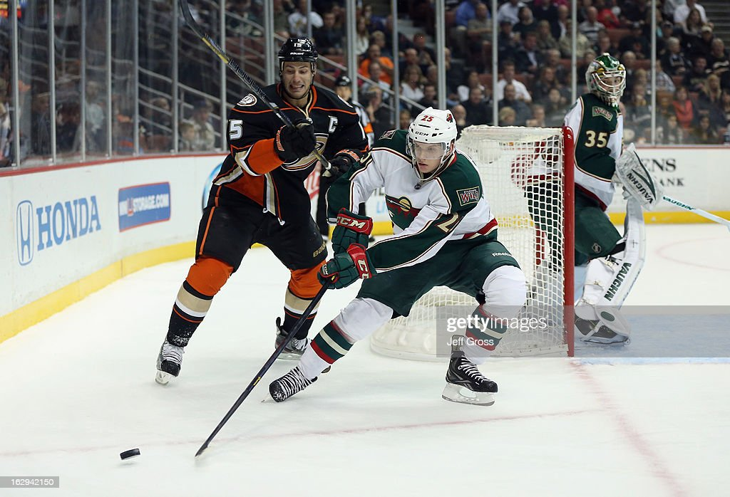Jonas Brodin #25 of the Minnesota Wild is pursued by Ryan Getzlaf #15 of the Anaheim Ducks for the puck in the first period at Honda Center on March 1, 2013 in Anaheim, California.