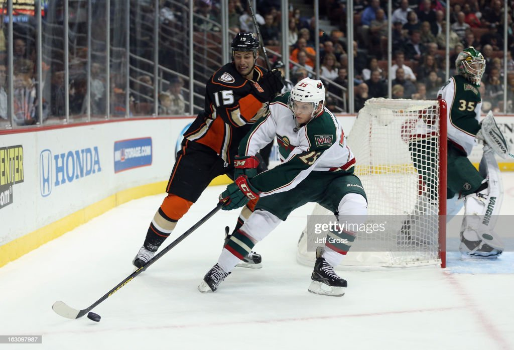 Jonas Brodin #25 of the Minnesota Wild is pursued by Ryan Getzlaf #15 of the Anaheim Ducks for the puck at Honda Center on March 1, 2013 in Anaheim, California.