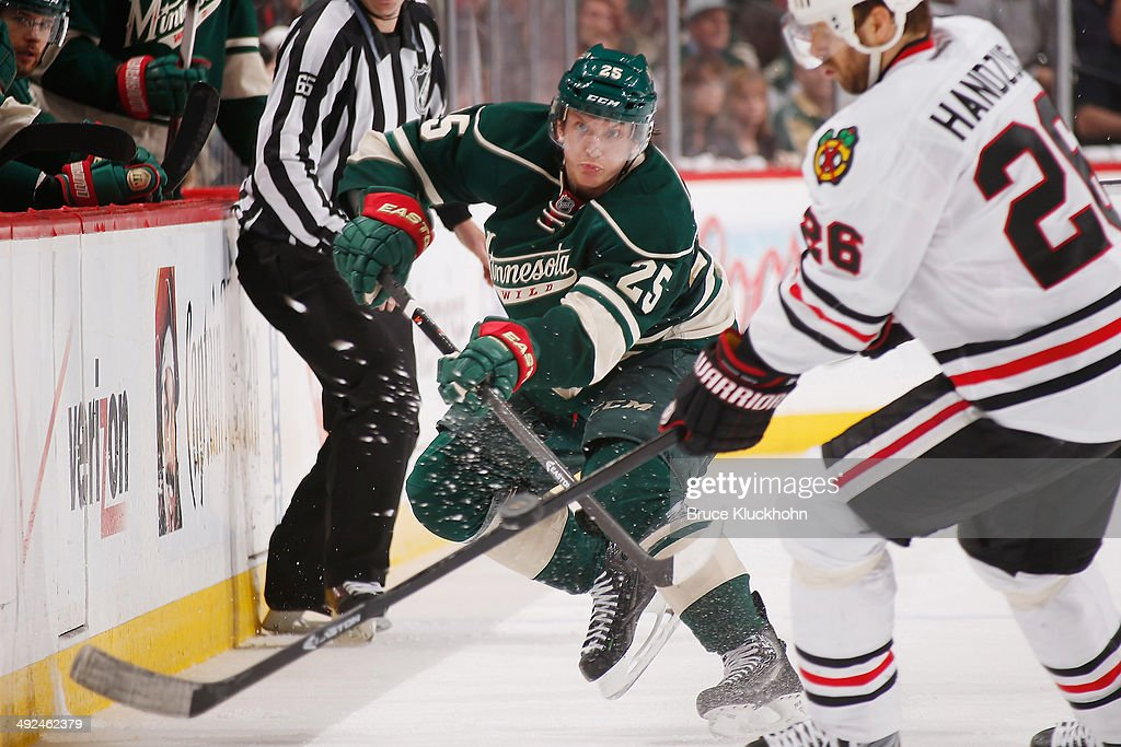Jonas Brodin #25 of the Minnesota Wild passes the puck against the Chicago Blackhawks during Game Six of the Second Round of the 2014 Stanley Cup Playoffs on May 13, 2014 at the Xcel Energy Center in St. Paul, Minnesota.