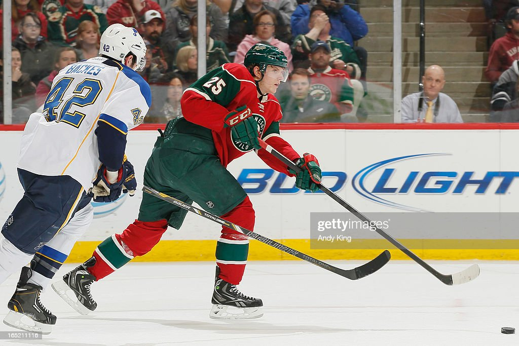 Jonas Brodin #25 of the Minnesota Wild passes the puck with <a gi-track='captionPersonalityLinkClicked' href=/galleries/search?phrase=David+Backes&family=editorial&specificpeople=2538492 ng-click='$event.stopPropagation()'>David Backes</a> #42 of the St. Louis Blues defending during the game on April 1, 2013 at the Xcel Energy Center in Saint Paul, Minnesota.