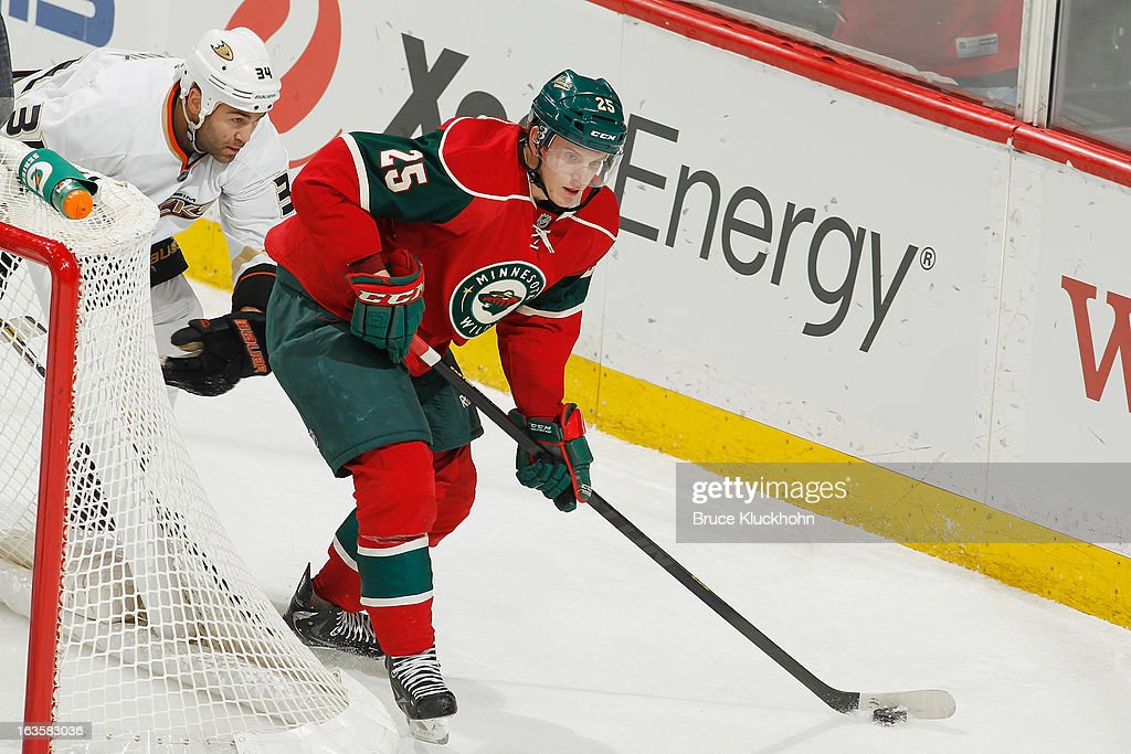Jonas Brodin #25 of the Minnesota Wild skates with the puck while <a gi-track='captionPersonalityLinkClicked' href=/galleries/search?phrase=Daniel+Winnik&family=editorial&specificpeople=2529214 ng-click='$event.stopPropagation()'>Daniel Winnik</a> #34 of the Anaheim Ducks defends during the game on March 12, 2013 at the Xcel Energy Center in Saint Paul, Minnesota.