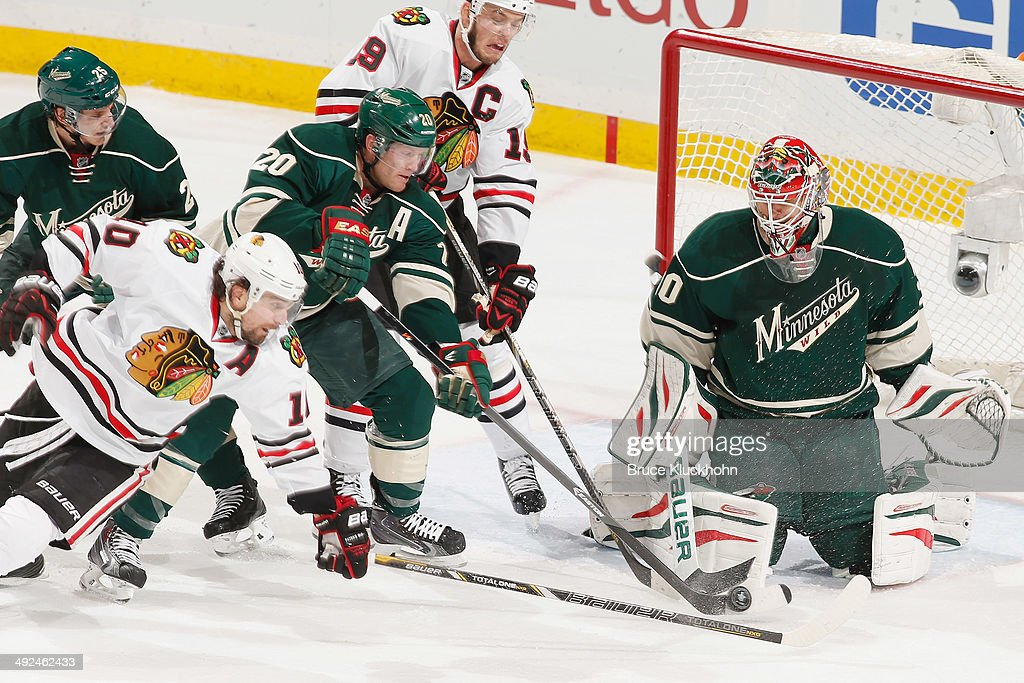 Jonas Brodin #25, Ryan Suter #20, and Ilya Bryzgalov #30 of the Minnesota Wild defend against Patrick Sharp #10 and Jonathan Toews #19 of the Chicago Blackhawks during Game Six of the Second Round of the 2014 Stanley Cup Playoffs on May 13, 2014 at the Xcel Energy Center in St. Paul, Minnesota.