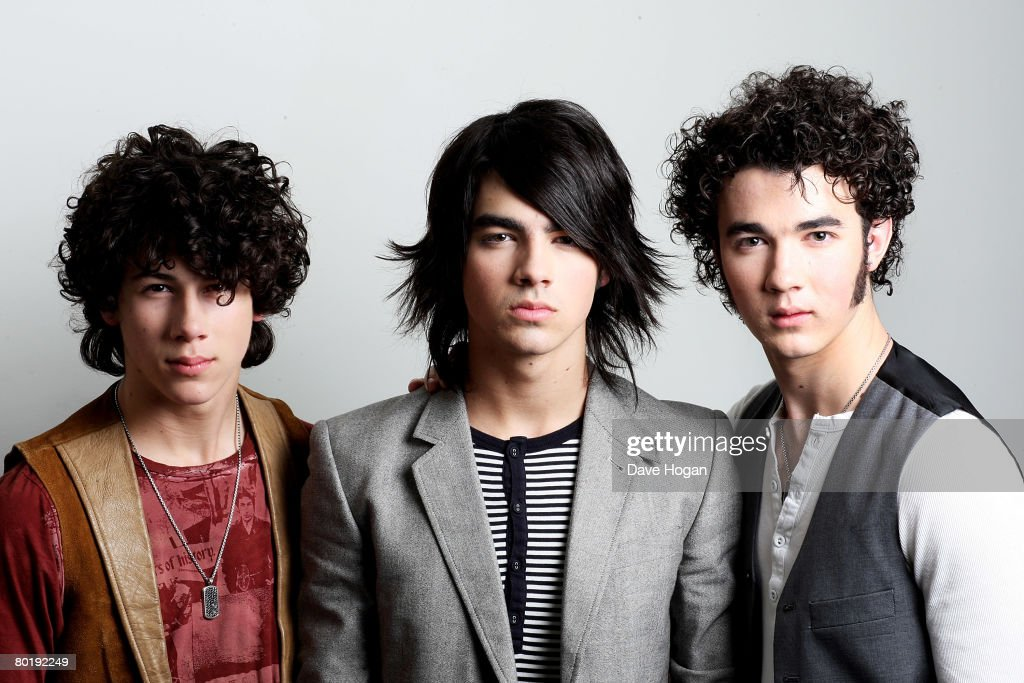 Jonas Brothers Nick Joe and Kevin pose for a portrait session in Chandler's Cross ahead of their showcase performance at a Universal Records...