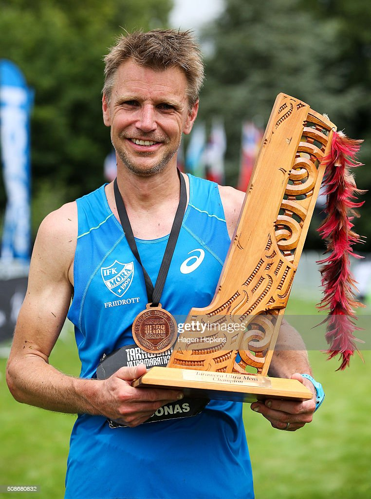 Jonas Buud of Sweden poses with the winner's trophy after winning during the Tarawera Ultramarathon on February 6, 2016 in Rotorua, New Zealand.