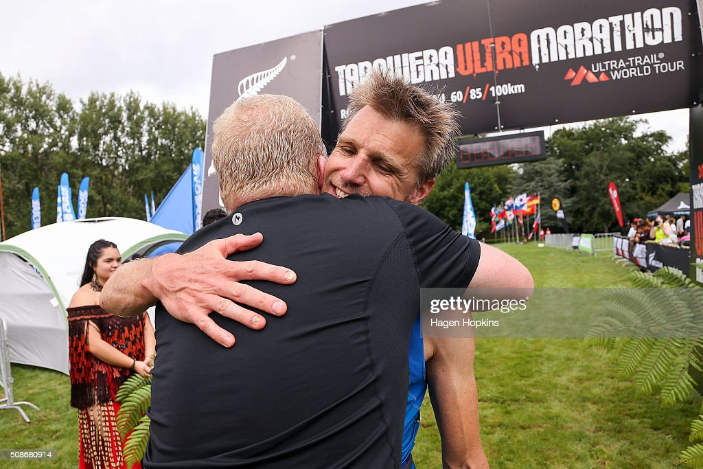 Jonas Buud of Sweden receives a hug from event organiser Paul Charteris after winning the Tarawera Ultramarathon on February 6, 2016 in Rotorua, New Zealand.