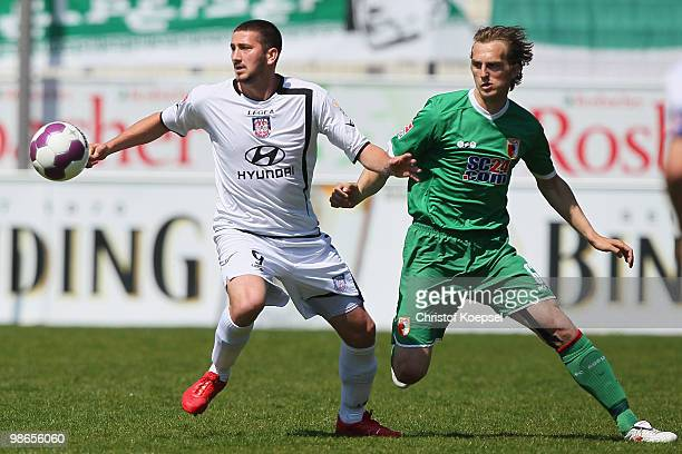 Jonas de Roeck of Augsburg challenges Sascha Moelders of Frankfurt during the Second Bundesliga match between FSV Frankfurt and FC Augsburg at the...