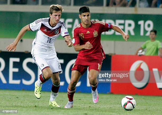 Jonas Fohnerbach of Germany competes with Marco Asenio of Spain during the UEFA U19 Championship 2015 final tournament match between Spain and...