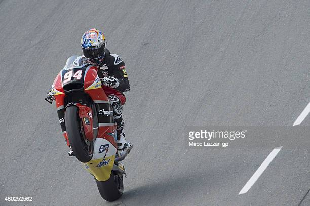 Jonas Folger of Germany and Arginano Gines Racing lifts the front wheel during the MotoGp of Germany Free Practice at Sachsenring Circuit on July 10...