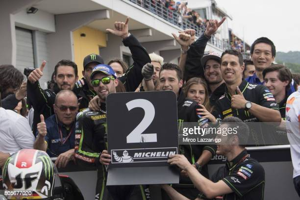 Jonas Folger of Germany and Monster Yamaha Tech 3 celebrates the second place with team under the podium at the end of the MotoGP race during the...
