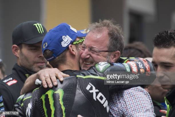 Jonas Folger of Germany and Monster Yamaha Tech 3 celebrates the second place with his father under the podium at the end of the MotoGP race during...