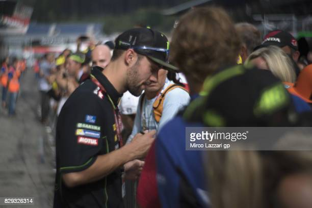 Jonas Folger of Germany and Monster Yamaha Tech 3 signs autographs for fans during the MotoGp of Austria Preview at Red Bull Ring on August 10 2017...