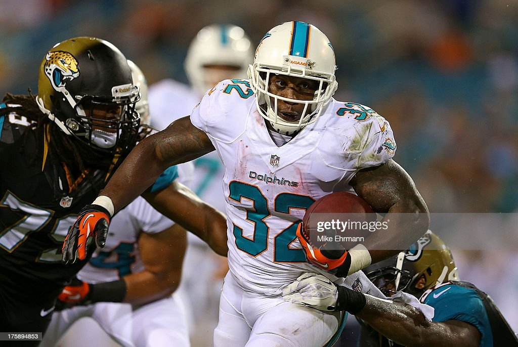 Jonas Gray #32 of the Miami Dolphins rushes during a preseason game against the Jacksonville Jaguars at EverBank Field on August 9, 2013 in Jacksonville, Florida.