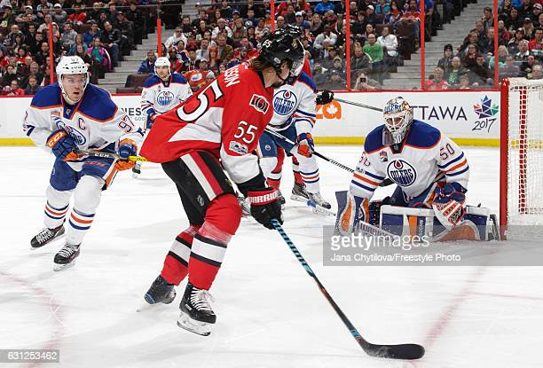 Jonas Gustavsson and Connor McDavid of the Edmonton Oilers defends against Erik Karlsson of the Ottawa Senators at Canadian Tire Centre on January 8...