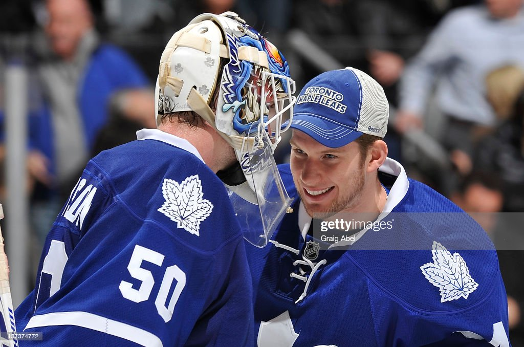 Jonas Gustavsson #50 and James Reimer #34 of the Toronto Maple Leafs celebrate the teams win over the Minnesota Wild during NHL game action January 19, 2012 at Air Canada Centre in Toronto, Ontario, Canada.