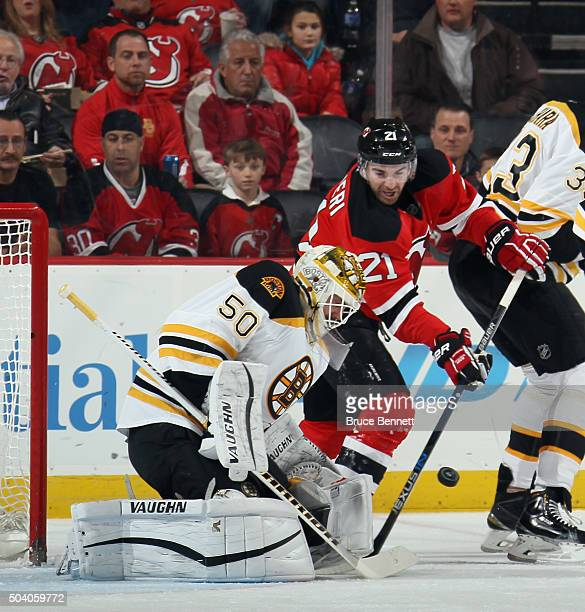 Jonas Gustavsson of the Boston Bruins makes the first period save on Kyle Palmieri of the New Jersey Devils at the Prudential Center on January 8...