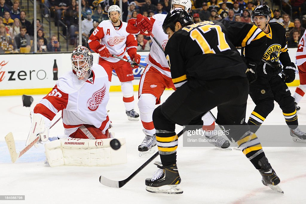 <a gi-track='captionPersonalityLinkClicked' href=/galleries/search?phrase=Jonas+Gustavsson&family=editorial&specificpeople=886789 ng-click='$event.stopPropagation()'>Jonas Gustavsson</a> #50 of the Detroit Red Wings defends the net against <a gi-track='captionPersonalityLinkClicked' href=/galleries/search?phrase=Milan+Lucic&family=editorial&specificpeople=537957 ng-click='$event.stopPropagation()'>Milan Lucic</a> #17 of the Boston Bruins at the TD Garden on October 14, 2013 in Boston, Massachusetts.