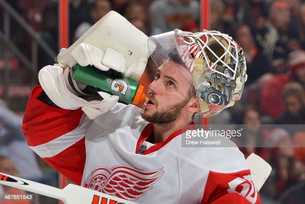 Jonas Gustavsson of the Detroit Red Wings drinks during the against the Philadelphia Flyers at the Wells Fargo Center on January 28 2014 in...