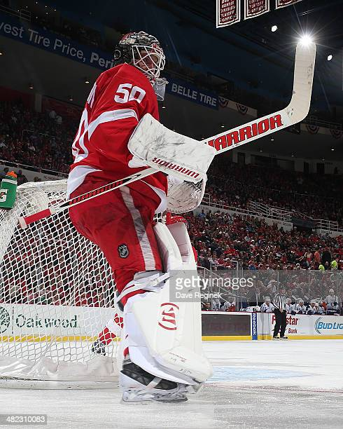 Jonas Gustavsson of the Detroit Red Wings follows the play against the Tampa Bay Lightning during an NHL game on March 30 2014 at Joe Louis Arena in...