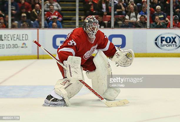 Jonas Gustavsson of the Detroit Red Wings gets ready to play the puck during the second period of the game against the Montreal Canadiens at Joe...